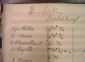 A colour detail of the to left-hand corner of the first page of the scherzo, with Mahler's pencil renumbering.