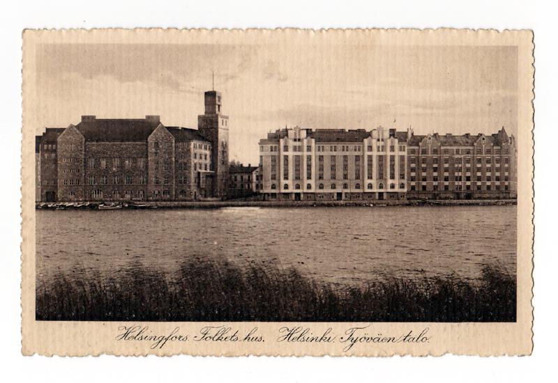 Sepia postcard (c.1911?) of the Kansantalo v iewed from the opposite bank of the Eläintenhanlahti