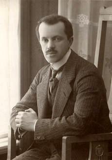 sepia photograph of a young Erkki Melartin, seated